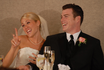 bride and groom react to their toast during their wedding reception at the best western sterling inn