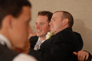 Groomsmen get chummy in this photograph taken at a reception at the best western sterling inn