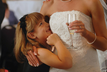 A guest flirts with this Troy, MI bride during her wedding reception at the sterlin Inn