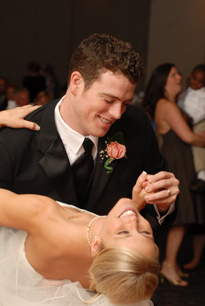 The groom dips the bride after their first dance as husband and wife as photojournalist marci curtis captures moments like this in mi