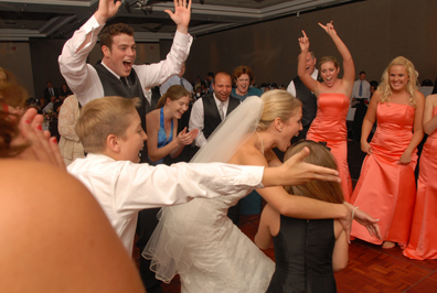 bride has a great time dancing at her wedding reception at the best western in sterling heights Michigan