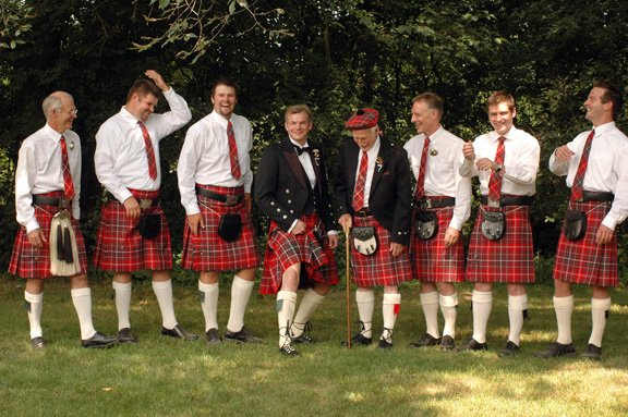 The men on Ormond's Scottish side of the family show off their legs under their kilts at this backyard, scottish themed wedding.