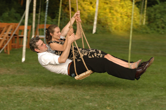 Ann Arbor wedding photographers job is to take wedding photos of wedding guests unusual things like swinging on swings. Backyard weddings usually aford for some pretty interesting and unique wedding photography moments.