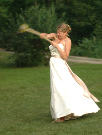 This Ann Arbor backyard wedding reception also had the bride throwing the hammer, a traditional Scottish Highland game. This is probably the only time this Ann Arbor wedding photographer will ever capture this at any wedding ever!