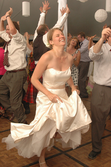 Dancing under a tent in their own Ann Arbor backyard provided lots of fun for this Ann Arbor wedding photographer.