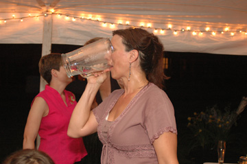 Here's one of my favorite series of Ann Arbor backyard wedding photographs. Only a mother would chug from the pitcher, then tell her daughter to do the same!