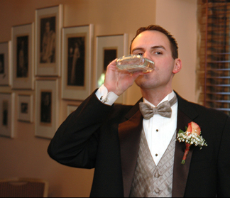Oakland County wedding photographer captures a groom to be taking a swig shortly before his Rochester, MI wedding