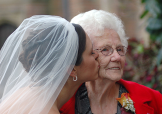 Meadow brook hall photojournalist in Michigan takes candid photos of the bride and her grandma before the wedding reception at Meadowbrook hall in michigan