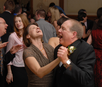 The father of the bride lets loose while dancing at the Troy, Michigan wedding reception