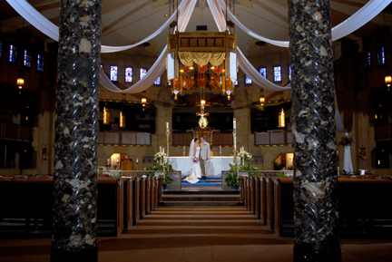 The catholic church is lit for photos after the couple's ceremony in Royal Oak, MI