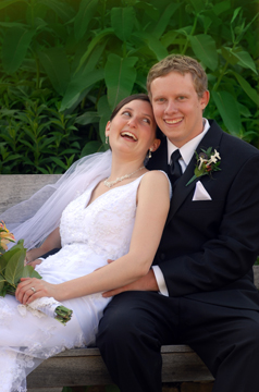 The bride and groom cuddle after their ceremony at the Ann Abor Botanical gardens
