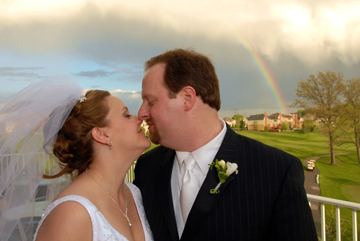 Beacon Hills Michigan couple kiss under rainbow