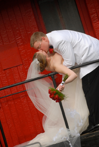 The groom dips the bride off a train in Macomb county in Michigan