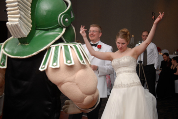 The bride gets ready to tango with sparty at their Sterling Heights, MI reception