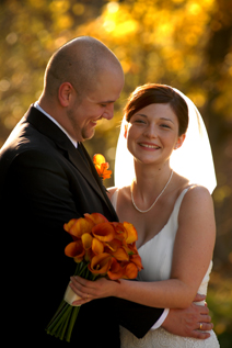 The bride and groom share a moment in beautiful fall light at Addison Oaks in Romeo Michigan
