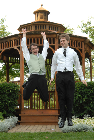 The groom and best man chest bump after the ceremony