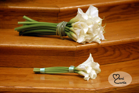 The Bride and maid of honor's flowers sit on the altar steps during the wedding ceremony in Macomb, MI