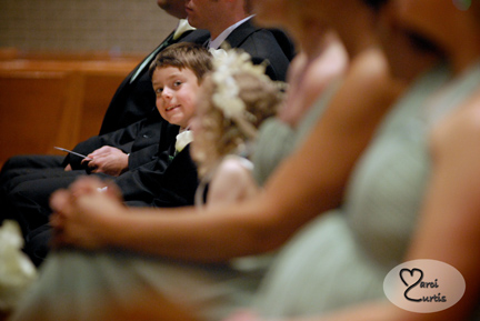 the ring bearer gets playful during the wedding ceremony