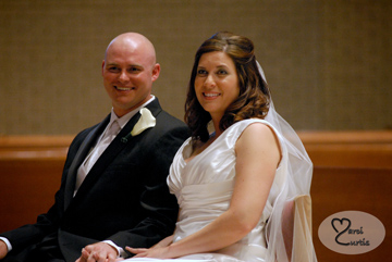 The bride and groom listen to the priest during their Macomb Michigan wedding