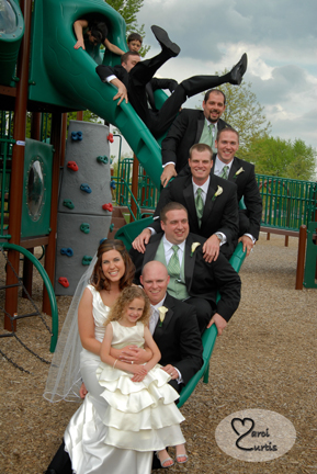 Part of the wedding party plays on the slides on the way to their MI wedding reception