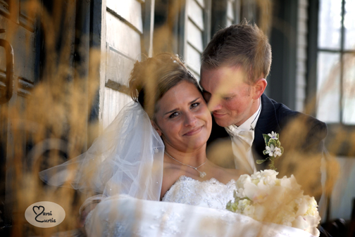 The bride and groom snuggle during photos in Chelsea, Michigan