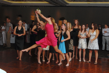 Wedding guest dives for bouquet during a Macomb County wedding reception