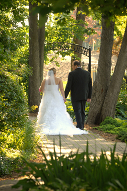 The bride and groom leave the Macomb County, Michigan park