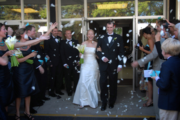 The bride and groom are pelted with rose pedals on their exit out of their Grosse Pointe Michigan church.