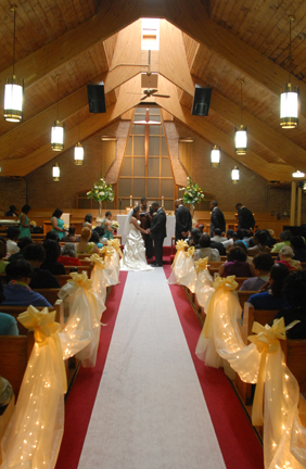 =bride and groom during their ceremony at the AME church in Southfield, MI