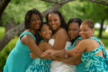 The bridesmaids pose for a photo in Pleasant Ridge, MIchigan