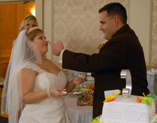 Warren Michigan couple put frosting on their noses during cake cutting.