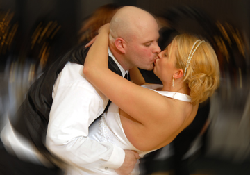 Sterling Heights couple snuggle during their first dance