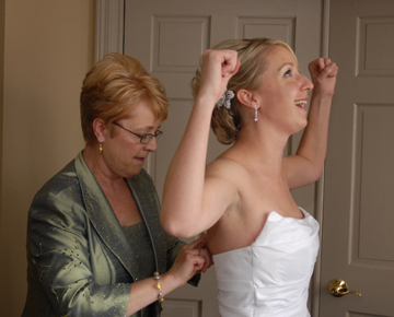 The bride triumphs over her dress on her wedding day in Troy, Michigan