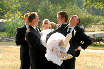 The groomsmen fake a broken back after lifting the bride at the Troy Historic Society.