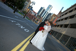The bride and groom kiss outside the Gem Theatre in downtown detroit Michigan