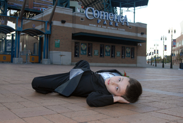 Joe's son plops down on the pavement at Comerica Park