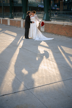 The bride and groom share a kiss at Comerica park downtown Detroit, MI