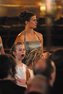 A flower girl yawns during the wedding service downtown detroit, Michigan