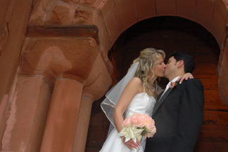 The bride and groom smooch at their downtown Detroit church