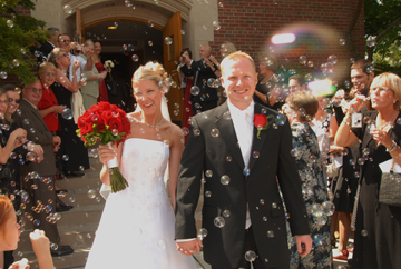 Michigan wedding photographer gets praise from MSU bride and groom.