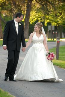 Addison Oaks couple goes for a walk before their Mi wedding reception.