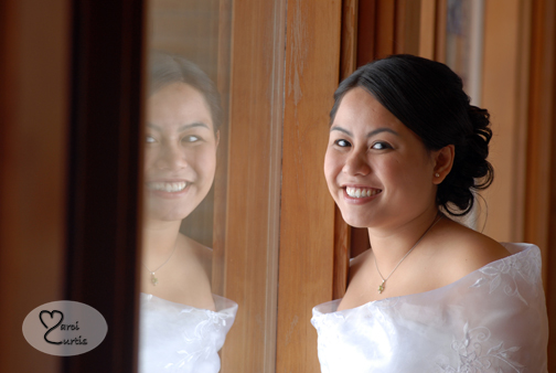 The bride is reflected in the Midland church's window