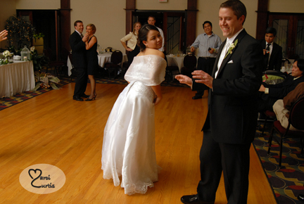 The bride teases the groom about dancing during their midland, Michigan wedding reception