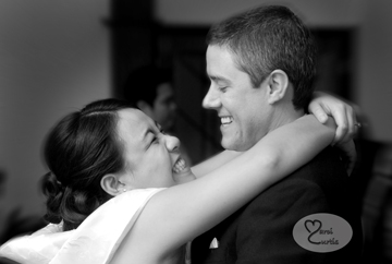 The bride and groom snuggle during dancing at their Midland, Michigan wedding reception.