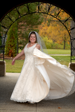 The bride gives it a twirl at a park in Michigan