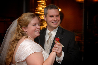 The bride and groom dance at their wedding reception at St. Johns Inn in Plymouth Mi