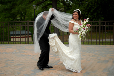 Groom gets caught in bride's veil after Black River Country Club wedding in Michigan