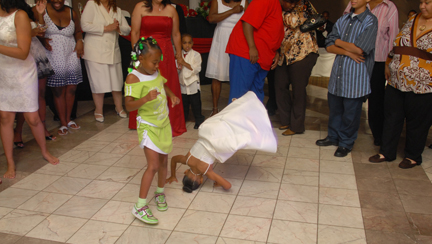 Kids dance at the wedding reception.