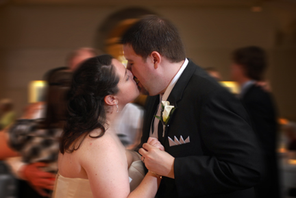 The bride and groom dance during their reception at the Henry Ford Museum in Dearborn, MI