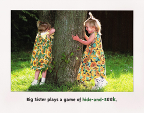 Michigan children's book writer and illustrator shows pages from the book big sister, little sister